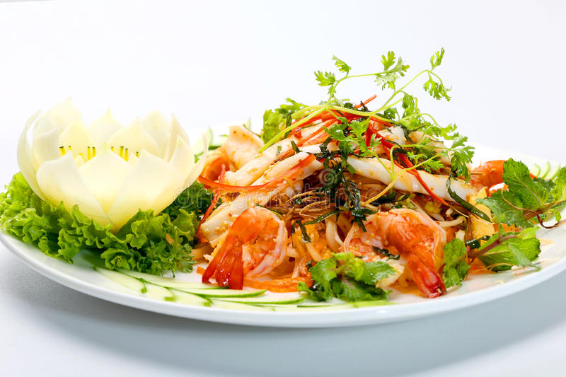 Seafood salad with shrimp, squids lettuce, mint leaves and herbs royalty free stock images