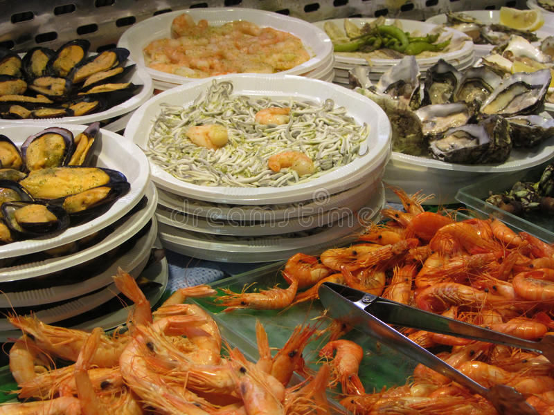 Seafood for sale in San Miguel Market, Madrid, Spain. Seafood including angulas, shrimp and oysters for sale in the famous San Miguel Market, Madrid, Spain stock photography