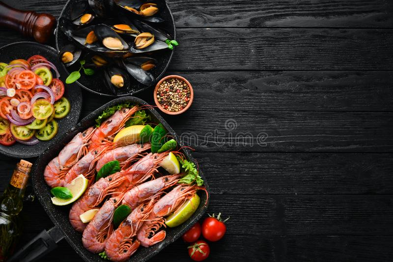 Seafood. Shrimp and mussels in a frying pan. stock photography