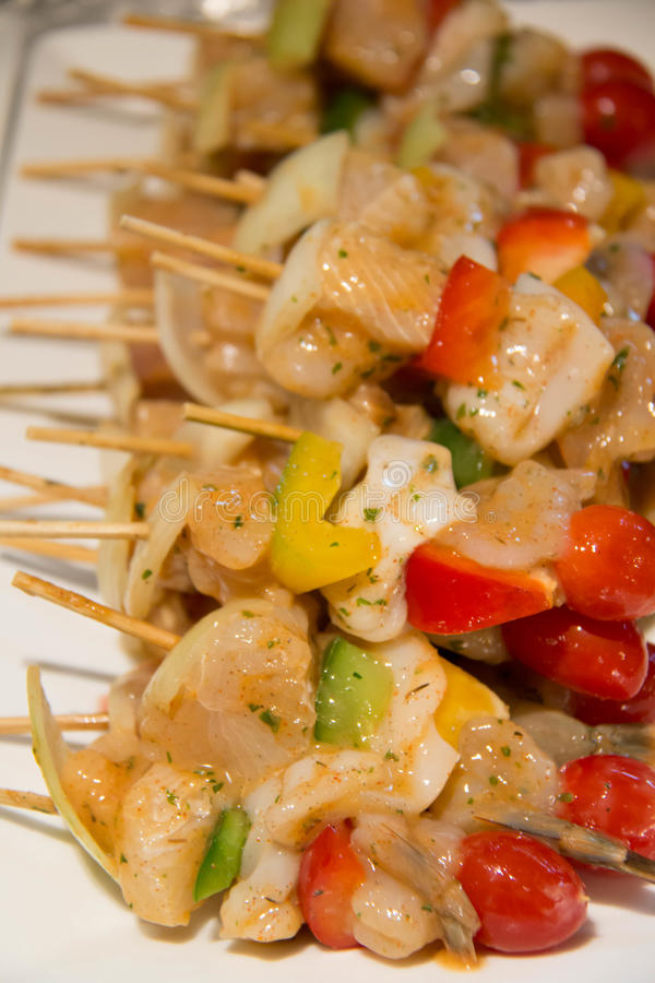 Seafood skewer shrimp squid prawn fish bell pepper Shallot stock images