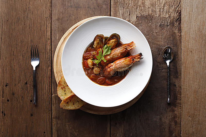 Seafood soup bouillabaisse in pot. French cuisine stock photo