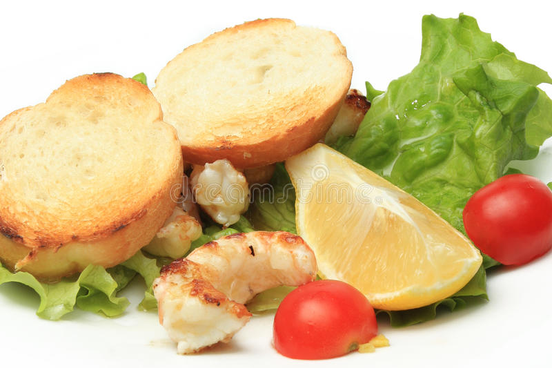 Seafood specialty. Shellfish specialty on white plate in restaurant royalty free stock image