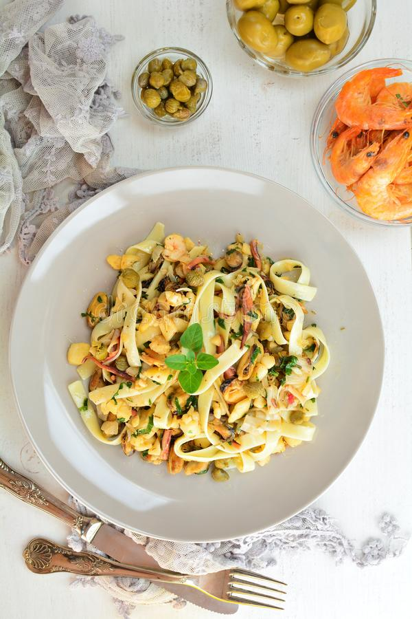 Seafood Tagliatelle with Olives and Salted Capers stock images