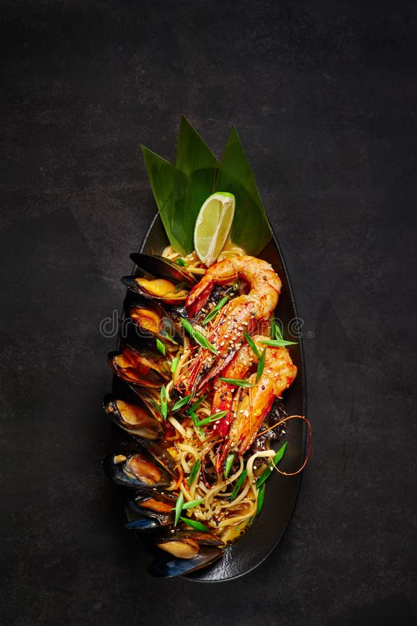 Seafood udon at black background royalty free stock photography