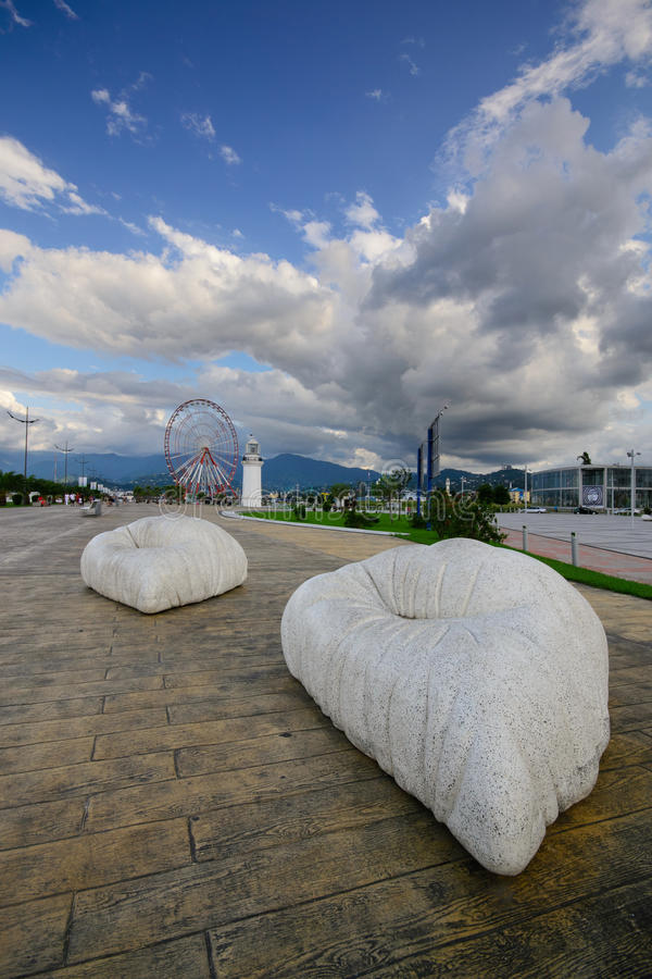 Seafront. Ferris wheel and lighthouse on the seafront of Batumi stock photos