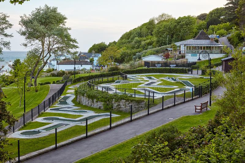 The Seafront gardens of Lyme Regis. West Dorset. England. The mini-golf field in the Seafront gardens (Langmoor and Lister Gardens) with the beautiful view of royalty free stock photography