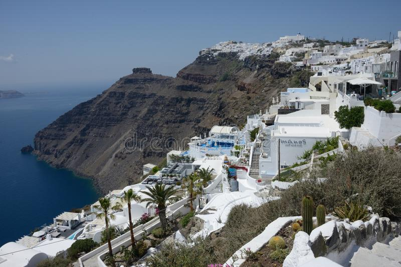 Panoramic view of the Fira town in Santorini island with hotel and residence surrounded by nature. Seafront panoramic view of the Fira town in Santorini island royalty free stock photos