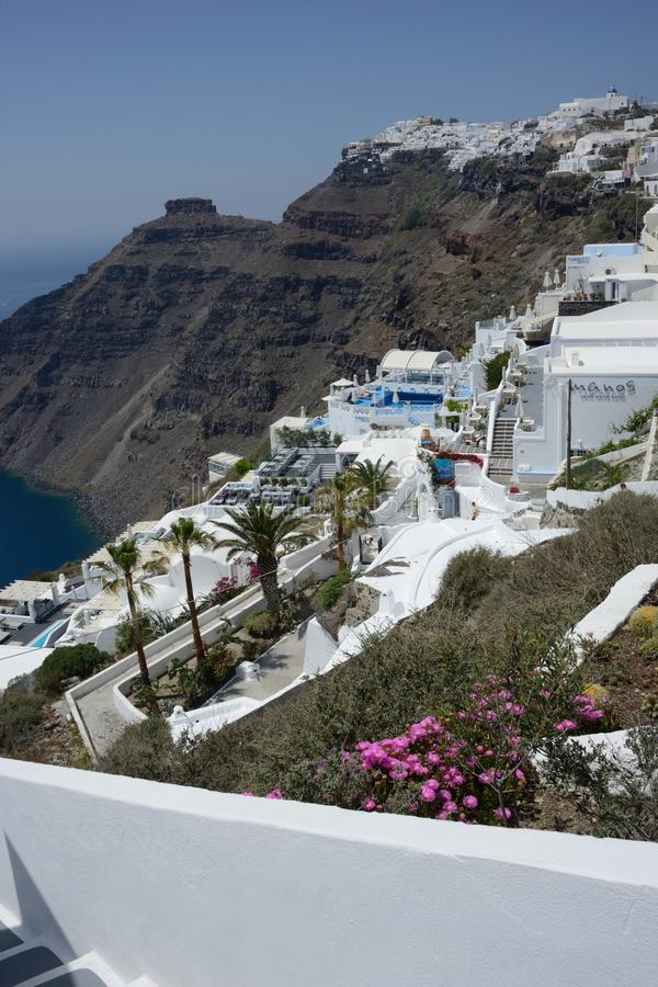 Panoramic view of the Fira town in Santorini island with hotel and residence surrounded by nature. Seafront panoramic view of the Fira town in Santorini island stock photography