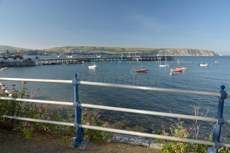 Seafront at Swanage on Dorset coast. The seafront at Swanage on the Dorset coast looking across the bay from Peveril Point royalty free stock image