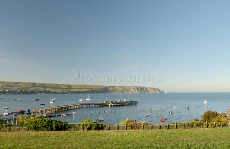 Seafront at Swanage on Dorset coast. The seafront at Swanage on the Dorset coast looking across the bay from Peveril Point stock photo