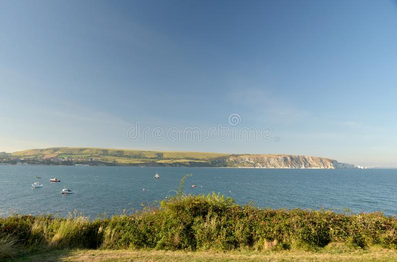 Seafront at Swanage on Dorset coast. The seafront at Swanage on the Dorset coast looking across the bay from Peveril Point royalty free stock photos