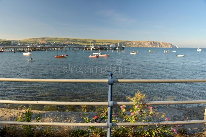 Seafront at Swanage on Dorset coast. The seafront at Swanage on the Dorset coast looking across the bay from Peveril Point stock photos