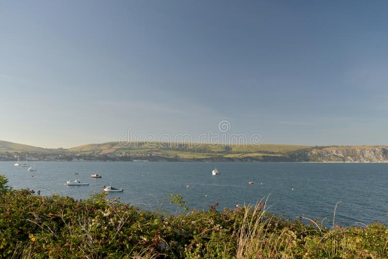 Seafront at Swanage on Dorset coast. The seafront at Swanage on the Dorset coast looking across the bay from Peveril Point stock image