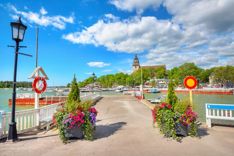 Seafront with wharf at small resort town Naantali. Finland. Quay with boats and yachts and view of small resort town Naantali. Finland stock photos