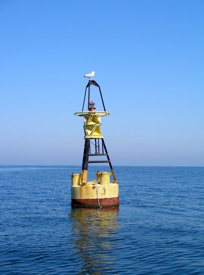 Seagull. Beacon, lighthouse, sea, blue sky, symbol stock image