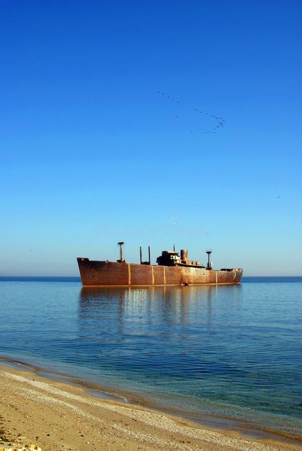 Seagulls over abandoned ship stock photos