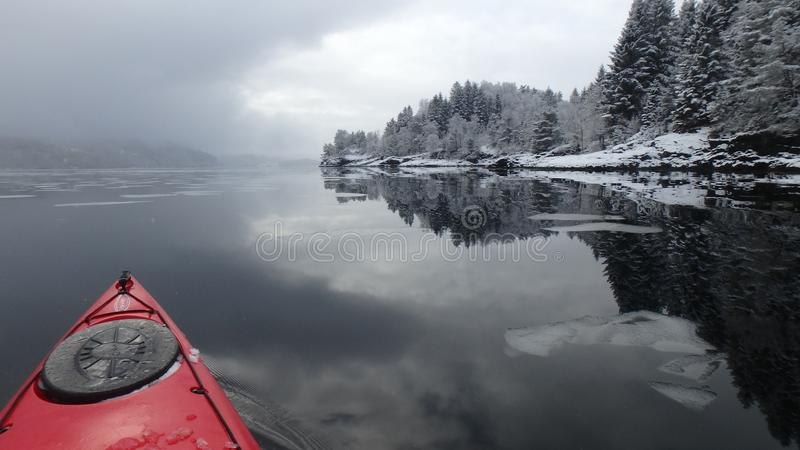 Seakayaking early in the morning with dawn royalty free stock photo
