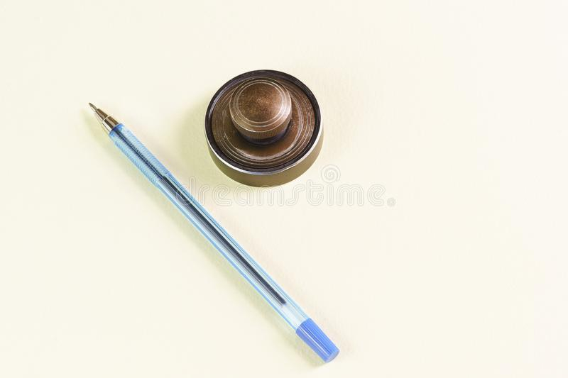 The attributes for the identity documents. Seal and ballpoint pen. The attributes for the identity documents royalty free stock image