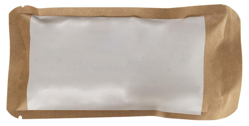 Sealed craft paper food, coffee, tea pack whth blank white stick. Sealed craft paper food, coffee, tea pack with blank white sticker isolated on white royalty free stock images