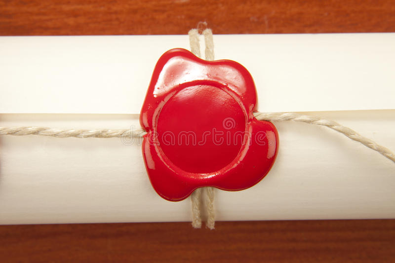 Sealed scroll document. Sealed paper scroll document and rope stock images