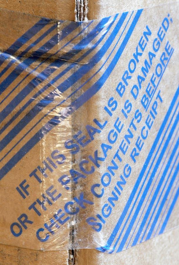 Download Sealing warning on package stock photo. Image of writing - 21366246
