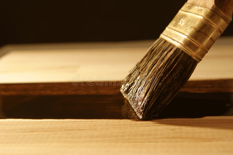 Sealing wood with brush stock images