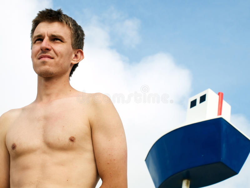 Seaman and the ship stock photo