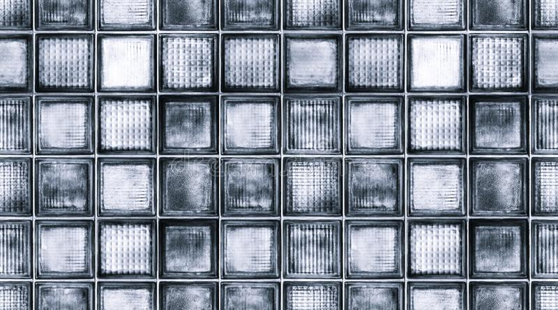 Seamless abstract textured pattern background of transparent dark blue  glass cubes in vintage retro style, panoramic web banner.  royalty free stock image