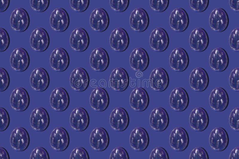 Seamless background Colorful eggs pattern chicken easter eggs. Pattern on a classic blue background. greeting card, wrapping paper.  royalty free stock photography