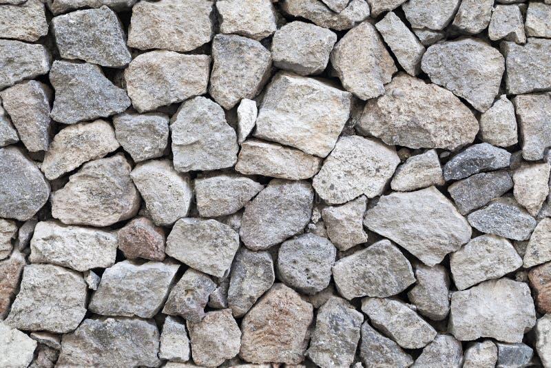 Seamless background gray granite stone wall stock image