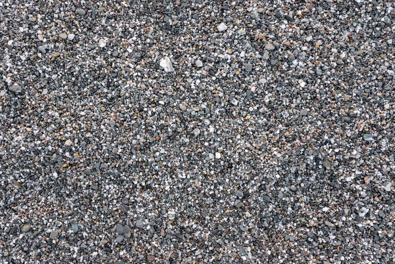 Seamless background made of gray pebbles royalty free stock photography