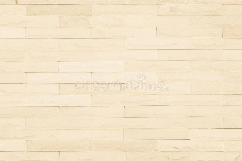 Seamless Cream pattern of decorative brick sandstone wall surface with concrete of modern style design decorative uneven have royalty free stock photos