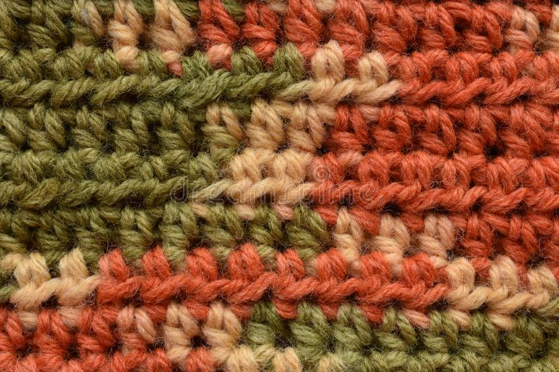 A seamless crocheted texture orange,green and beige. A macro seamless crocheted texture, green, orange, beige, dc and fldc royalty free stock photos