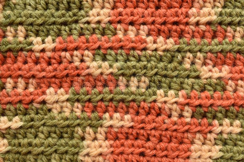 A seamless crocheted texture orange,green and beige. A macro seamless crocheted texture, green, orange, beige, dc and fldc royalty free stock photography