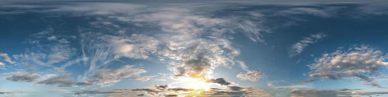 Seamless dark sky before sunset hdri panorama 360 degrees angle view with beautiful clouds for use in 3d graphics or game. Development as sky dome or edit drone stock image