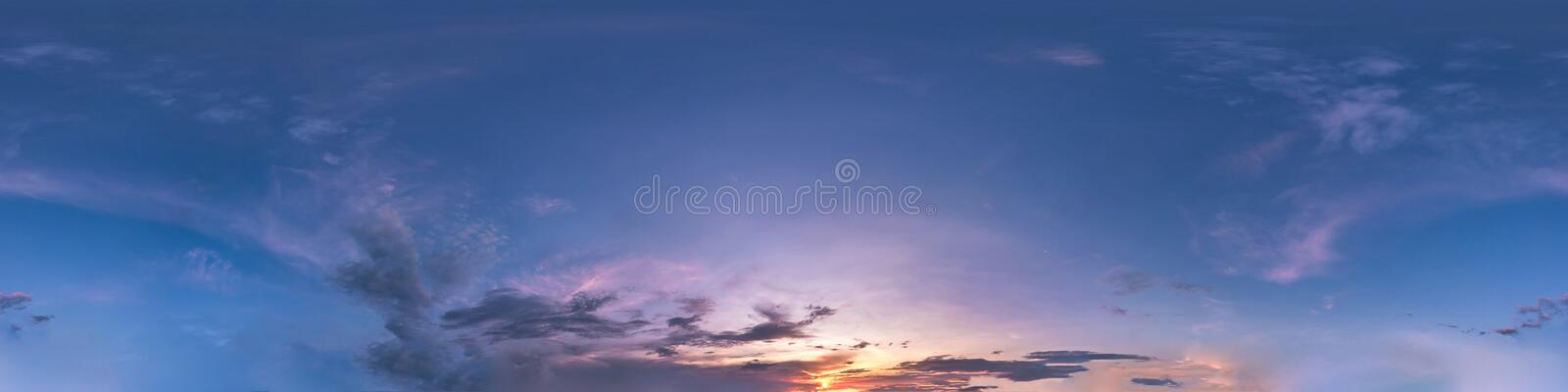 Seamless dark sky before sunset hdri panorama 360 degrees angle view with beautiful clouds for use in 3d graphics or game. Development as sky dome or edit drone royalty free stock photos