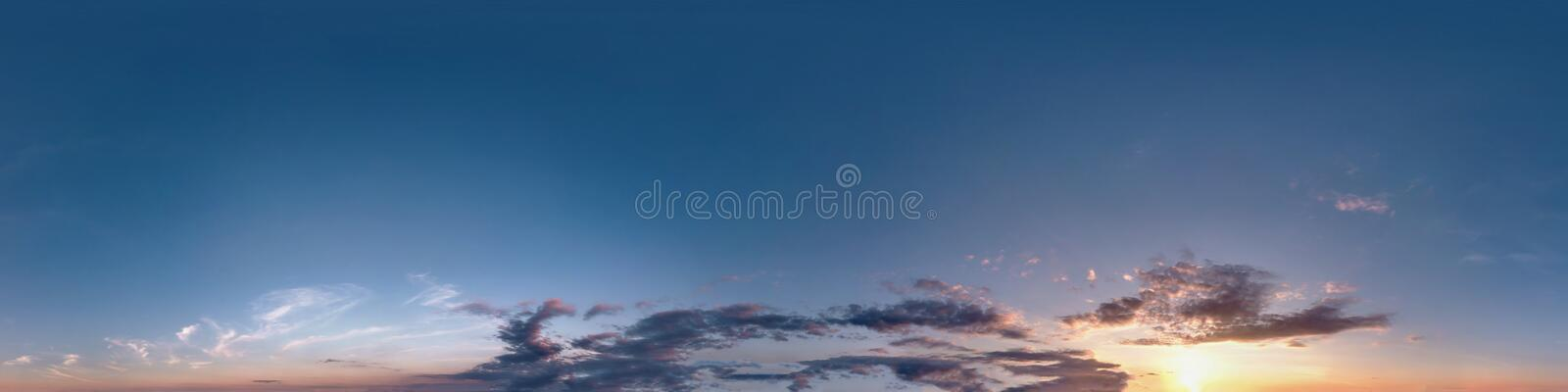 Seamless dark sunset sky hdri panorama 360 degrees angle view with beautiful clouds  with zenith for use in 3d graphics as sky. Dome or edit drone shot stock photos