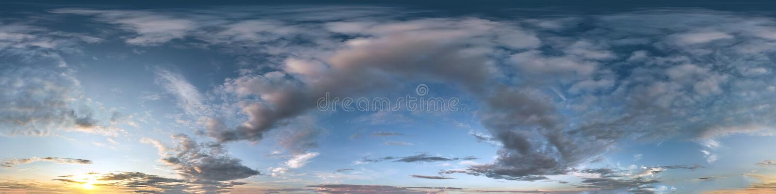 Seamless dark sunset sky hdri panorama 360 degrees angle view with beautiful clouds  with zenith for use in 3d graphics as sky. Dome or edit drone shot royalty free stock photos