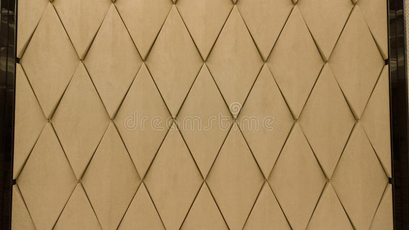 Seamless leather diamond shape pattern in beige color by craftmanship / seamless texture / abstract background material / handmade. Style stock image