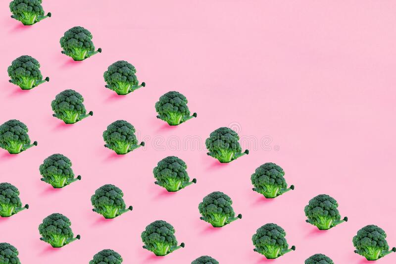 Seamless minimalistic pattern isometric with broccoli on a pink background. Photo collage, vegan pop art design, vegetable backdrop, diet, healthy food stock photos