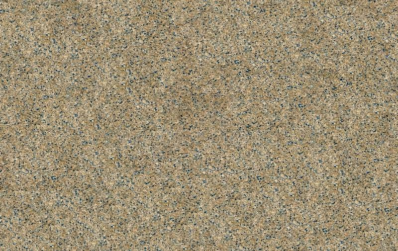 Seamless mottled gray and beige granite texture with dark blue splashes. stone surface royalty free stock photo
