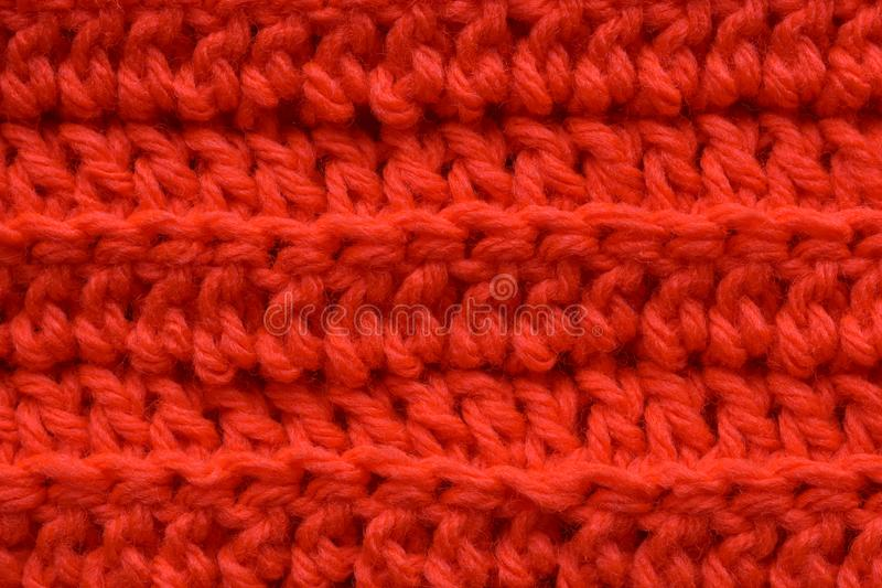 A seamless orange crocheted texture. Horizontal of a seamless orange crocheted texture, dc, and fldc royalty free stock image