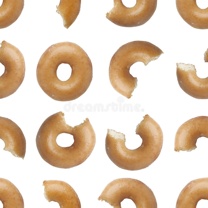 Seamless pattern of bites taken off a donut stock photos