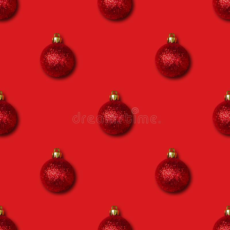 Seamless pattern with Christmas decorations on red background. Christmas abstract background.  stock images