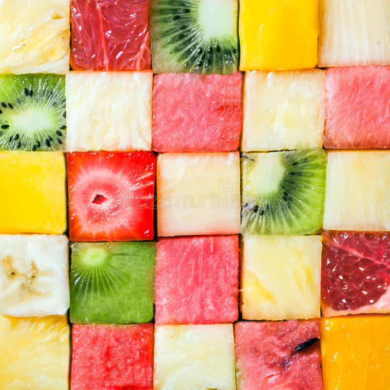 Seamless pattern of colorful fresh fruit cubes royalty free stock image