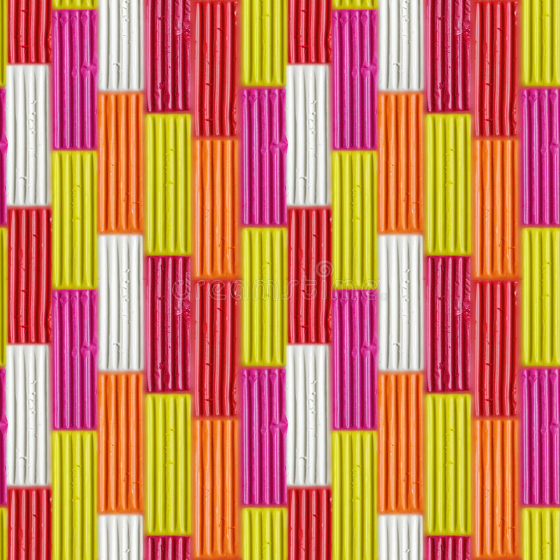 Seamless pattern of colorful plasticine sticks. Rainbow modeling clay piece for children play and creativity royalty free stock photography