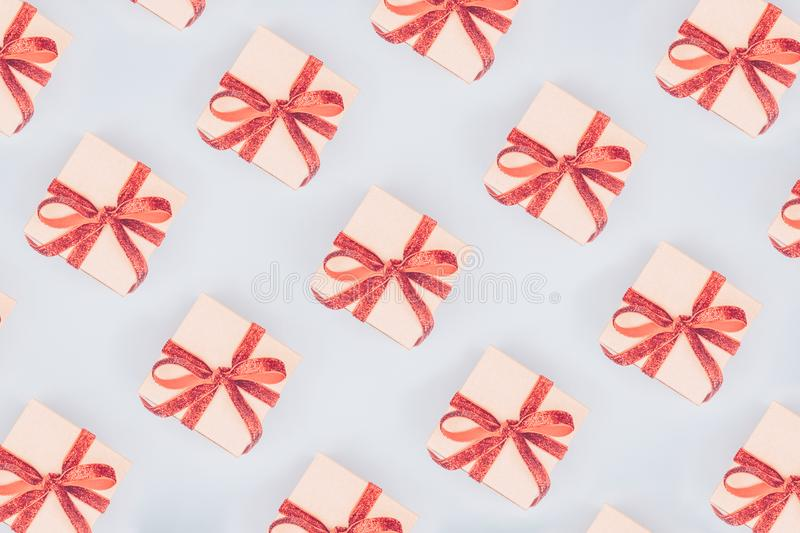 Seamless pattern of craft boxes with red ribbon bows. Valentine royalty free stock photos