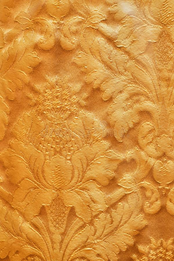 Seamless pattern. Golden textured curls. Brilliant lace, stylized flowers. Openwork weaving delicate, golden background, royalty free stock photo