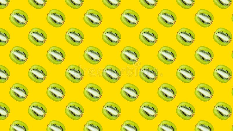A seamless pattern with green kiwi stock photography