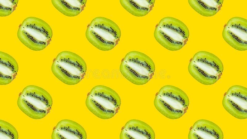 A seamless pattern with green kiwi stock photo